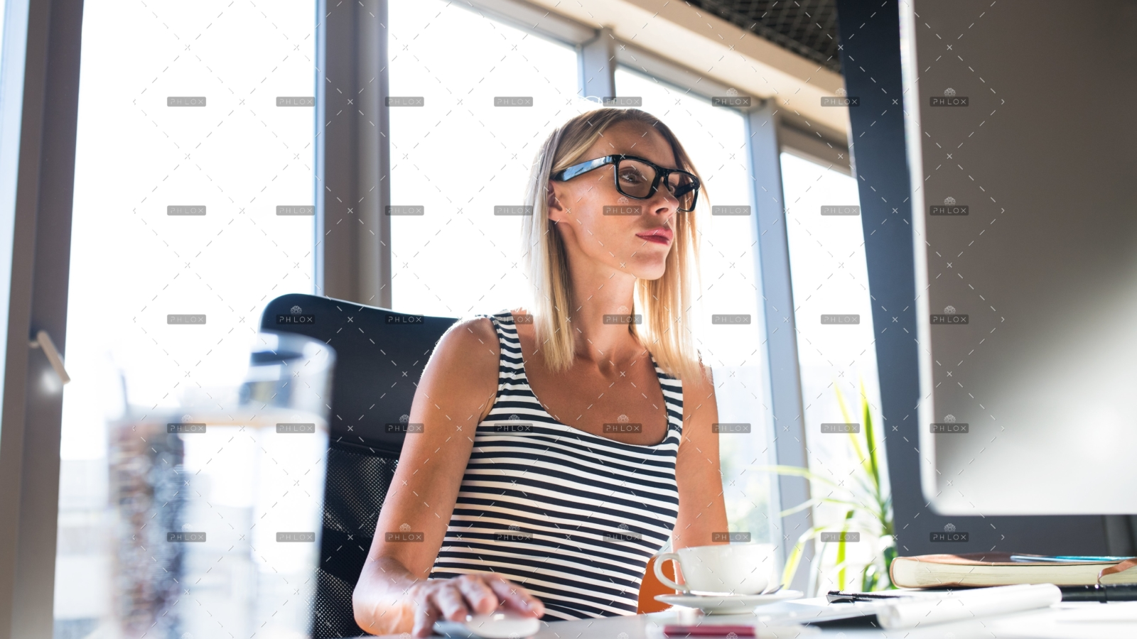 demo-attachment-838-businesswoman-with-computer-in-her-office-working-PV9JHZE
